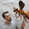 Thomas holding a copper Bee sculpture. Made by Thrussells