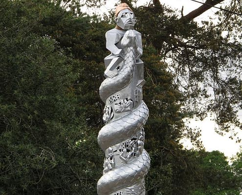 sculpture of a snake and imagery of HM Stanley the explorer. Public Art Wales