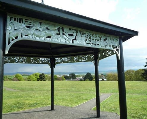 bandstand structure with relief metal imagery in park land. Made by Thrussells. Public Art Cornwall