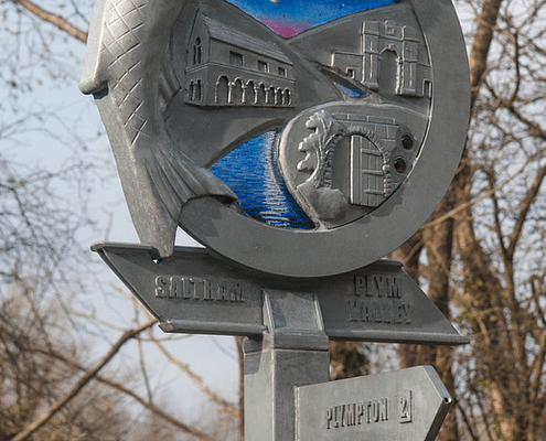 Waymarker sign made of metal and night sky glass. Fish and railway themed. Plymouth public art