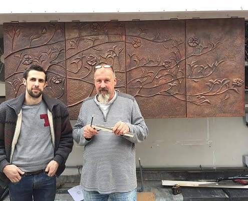 Thomas and Gary with their copper Repoussé tree wall sculpture panels. Made by Thrussells. Mayfair, London