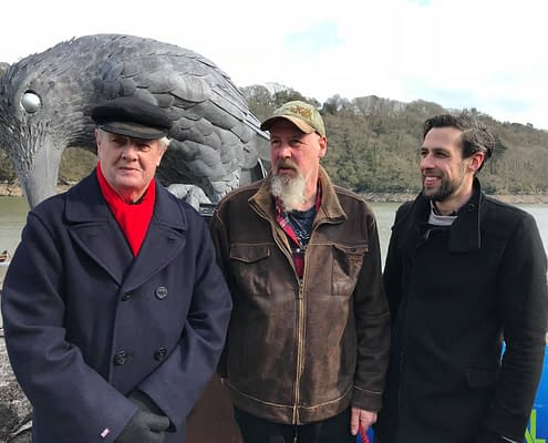 Son of Daphne Du Maurier's Kit Browning unveiled the 'Rook With A Book' sculpture. Kit, Gary and Thomas pose with the Rook sculpture.