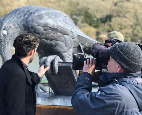 Thomas is filmed while explain how the Rook sculpture was made.
