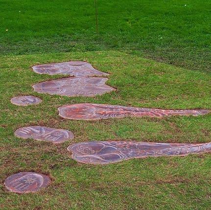 copper bum imprint on grass. Plymouth public art