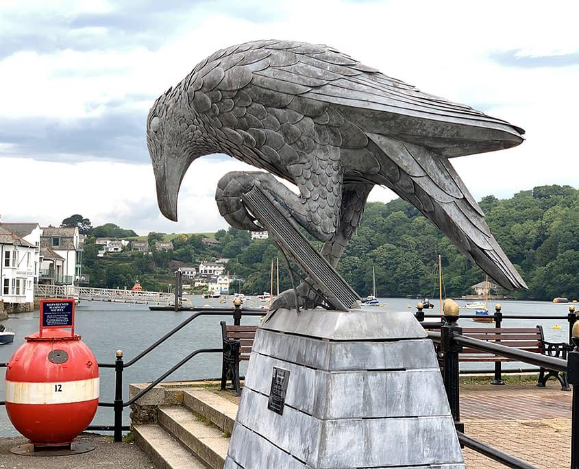 Rook with a book on Fowey town quay. public art Fowey Thrussells